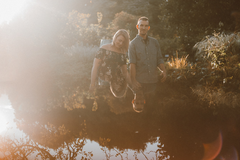 Couple strolls through the botanical gardens in Green Bay, WI. Couples photography by Anna Gutermuth.