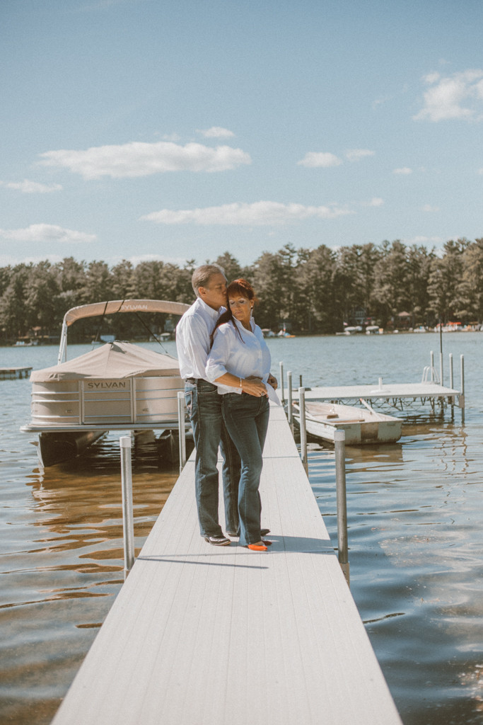 Couple standing on the dock near the lake. Lifestyle Photography by Anna Gutermuth.