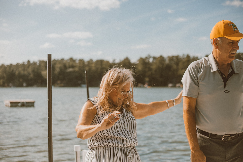 Wife dancing on the dock. Lifestyle Photography by Anna Gutermuth.
