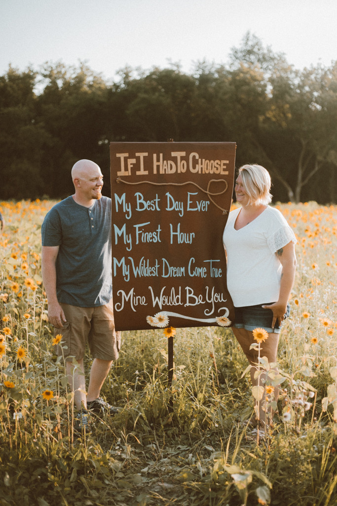Mom and dad stare at each other lovingly. Lifestyle Photography by Anna Gutermuth.