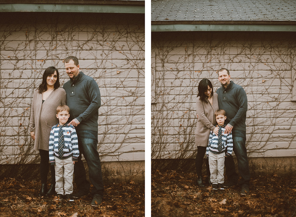 Mom, dad, and son pose in the backyard during their maternity lifestyle photography session.
