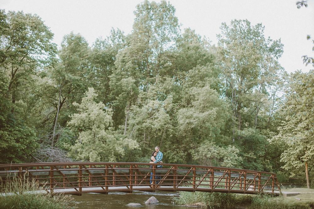 Modern, light-inspired engagement session at Brainard's Bridge Park in Waupaca, WI.