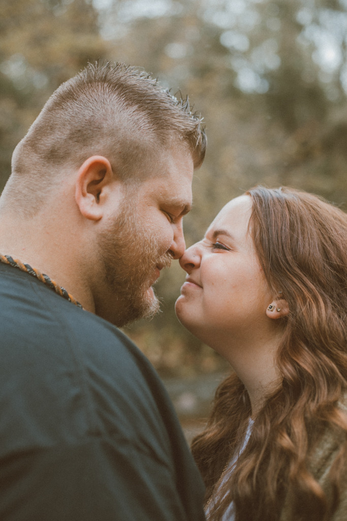 Couple sharing a funny moment. Engagement photography by Anna Gutermuth.