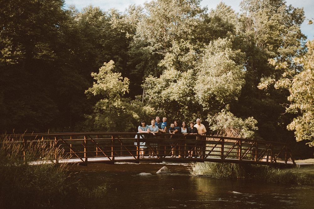 Extended family on bridge. Lifestyle family photography by Anna Gutermuth.