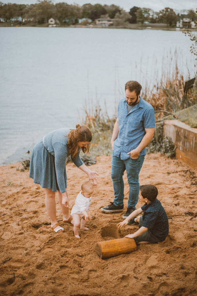 Family plays in the sand at Rock Lake. Lifestyle family photography in Trevor, WI.