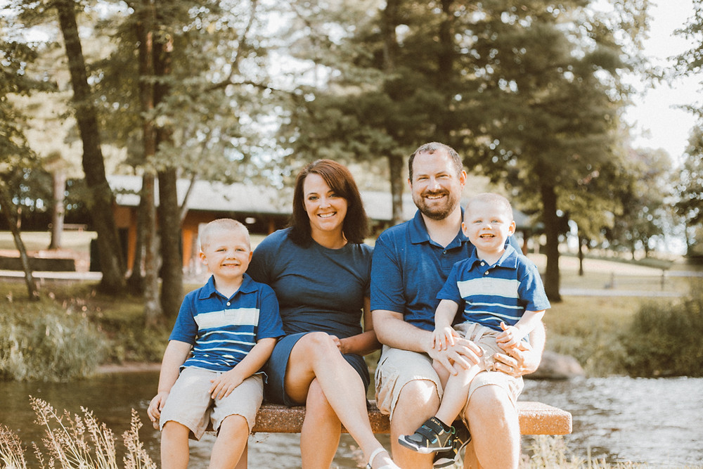 Mom and dad and two little boys. Lifestyle family photography by Anna Gutermuth.