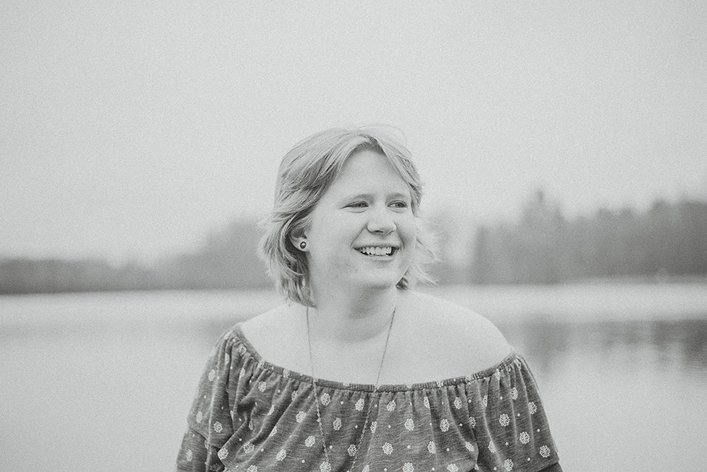 Woman laughing in black and white. Wisconsin Lifestyle Photography.