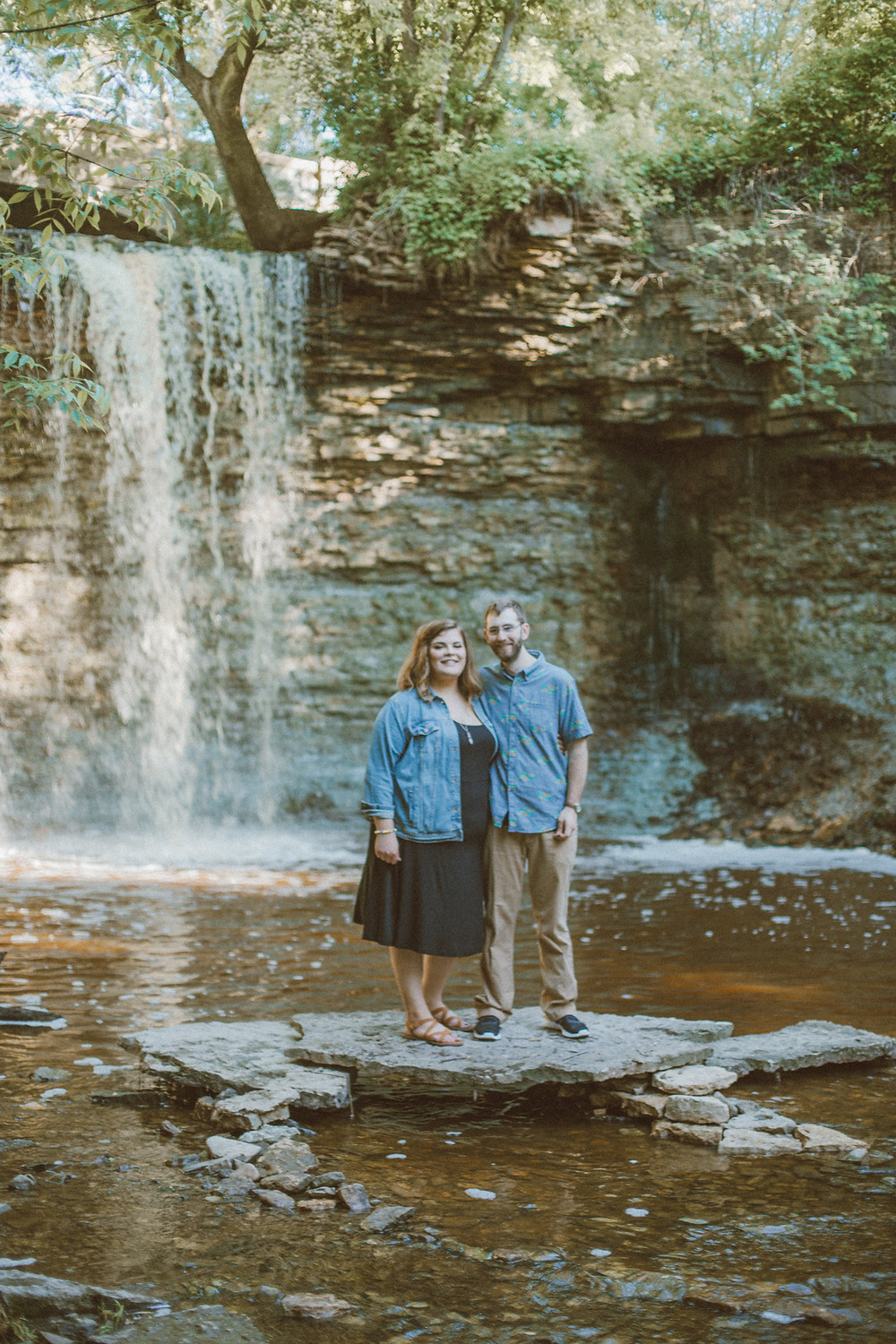 Lifestyle waterfall engagement session at Wequiock Falls in Green Bay, WI.