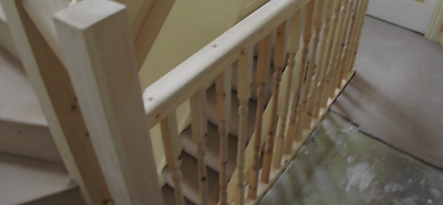 new staircase and banister leading to lo