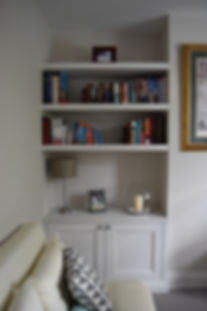 bespoke Alcove unit with floating shelves, builtin cupboards.