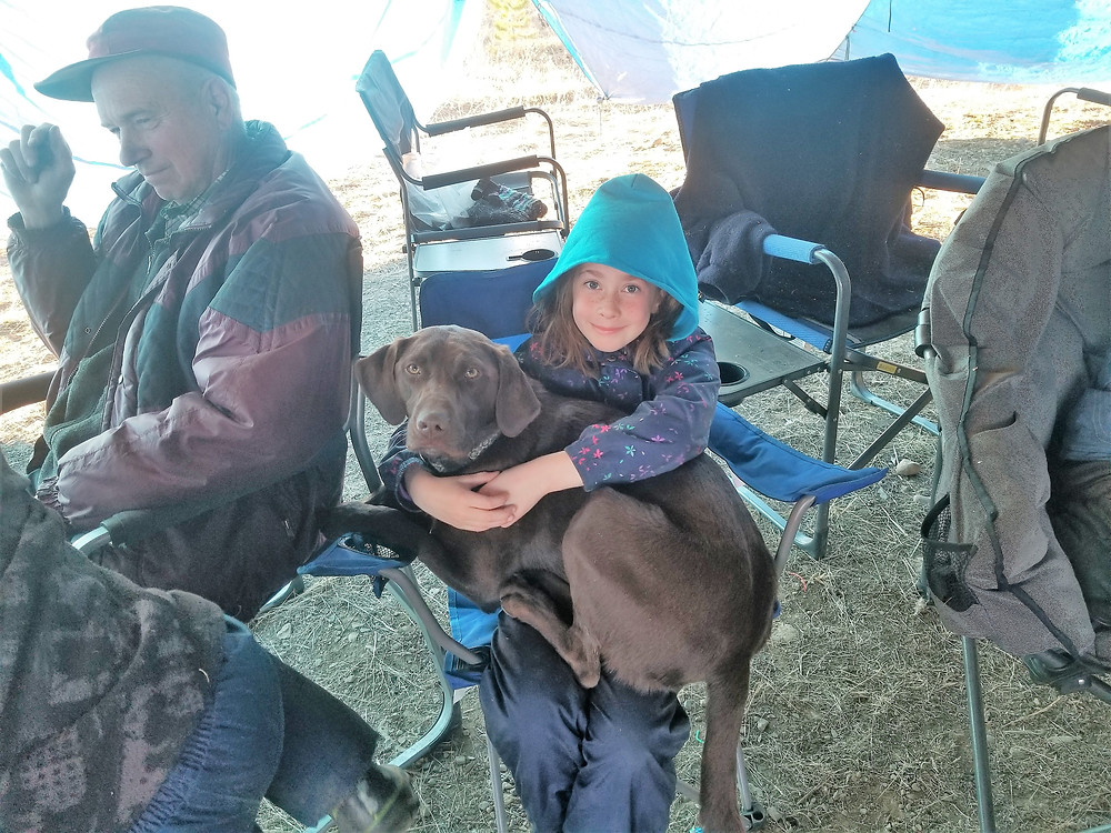 Keeping Sarah warm camping