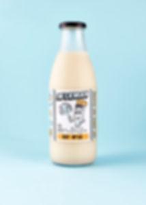 Glass bottle of oat milk