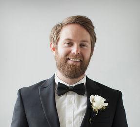 Wedding portraits in Dubai - Portrait of groom in a black tuxedo