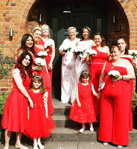 wedding photo with people in red dresses.PNG