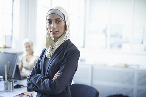 Young woman standing in office.jpg