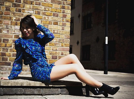 model wearing a blue dress.PNG