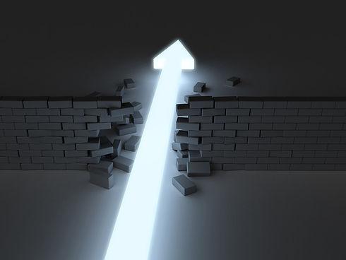 light coming through broken brick wall.jpg