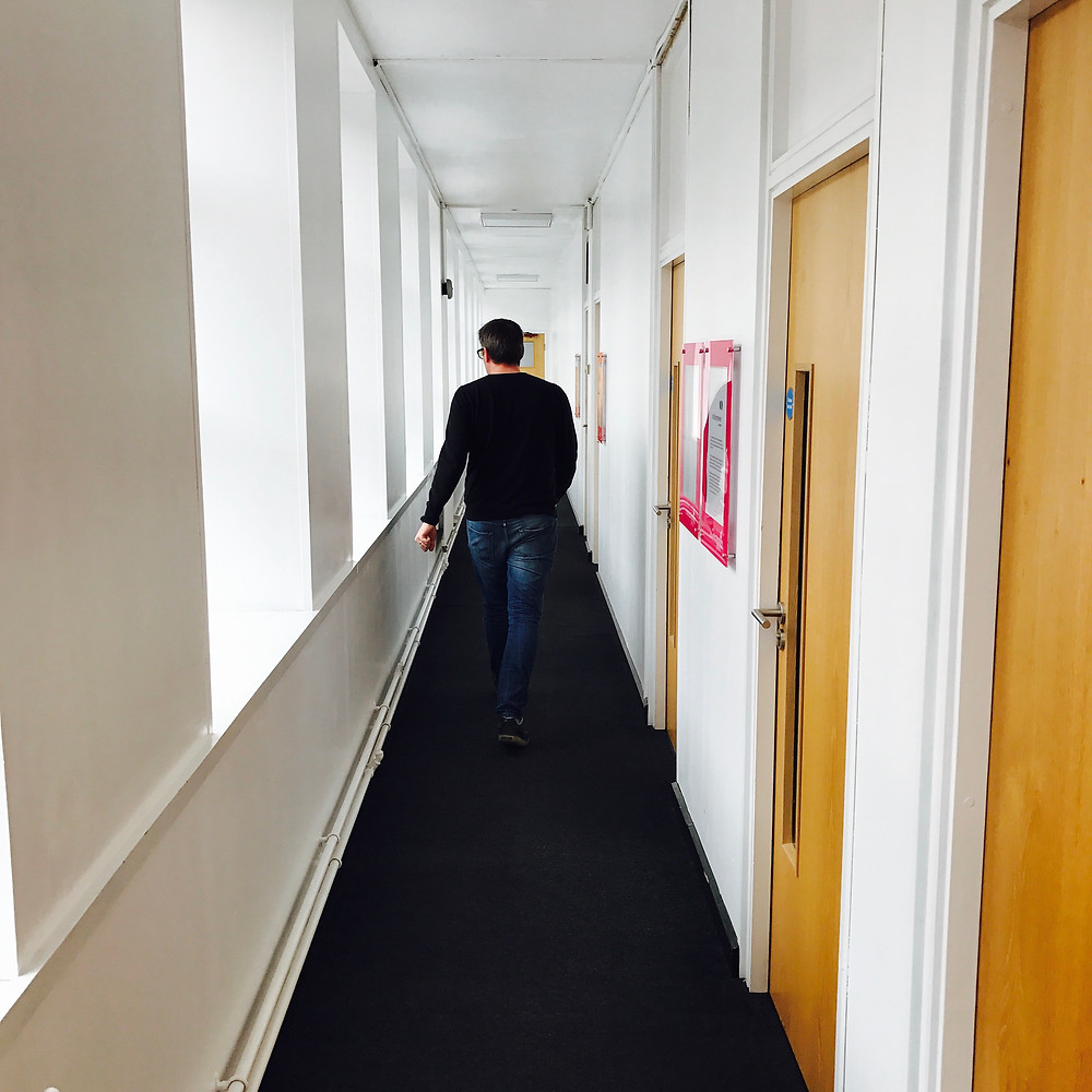 This image is a photograph of the long corridor to our new office space.
