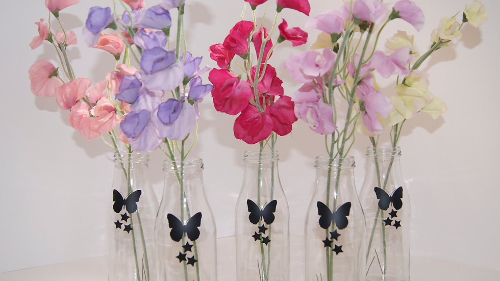 Sweetpeas in bottles