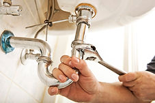 plumber-fixing-sink.jpg