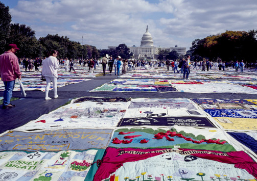 Color photo of the NAMES Project AIDS quilt on the lawn in Washington, D.C. in 1987.