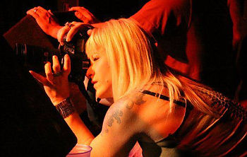 photo of Brigette Supernova photgraphing a music concert
