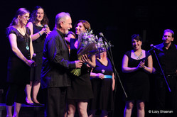 Jeff Meshel gets flowers at the end of Vocalocity concert