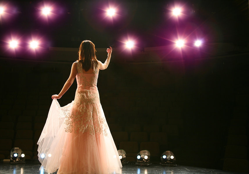 girl in long gown performing on stage.jp