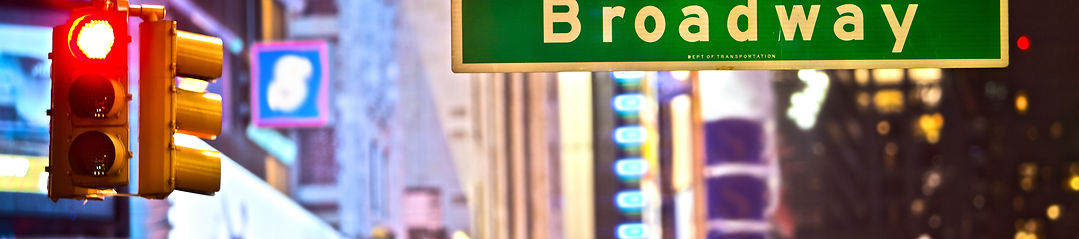 Broadway sign and red stop light in New
