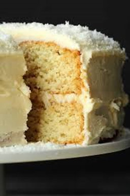 Coconut cake with coconut shards and butter cream filling