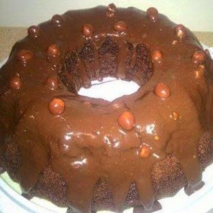 Millionaires cake with chocolate ganache