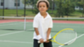 Boy Holding Racket_edited.jpg