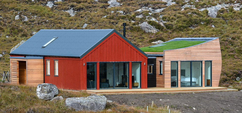 House design red cladding curved turf roof