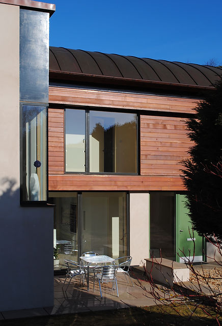 Moden house at Nairn with Cedar cladding and copper roof