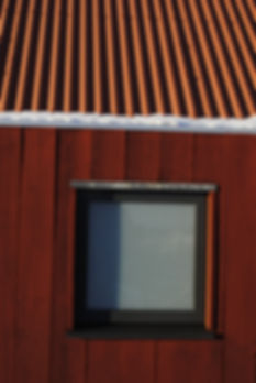 Red wood roofing and window with snow porteous architects