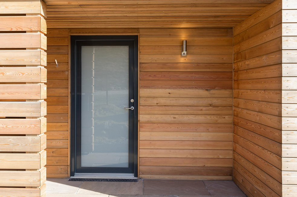 covered entry with larch cladding