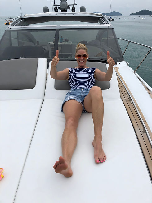 lyns on boat thumbs up.jpg