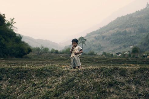 0016_boy in grass-punakha.jpg