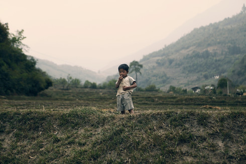 0016_boy in grass-punakha.jpg