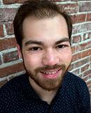 Dylan Omori McCombs Headshot.jpg
