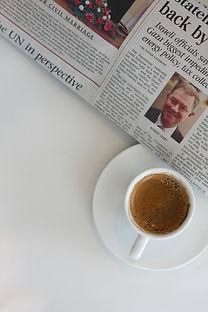 Newspaper and espresso.