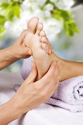 Foot massage in the spa salon in the gar