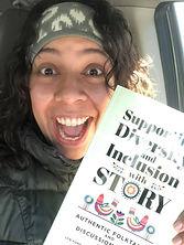 Jasmin with Diversity Book.jpg