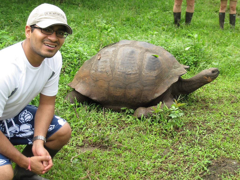 Sachin Shah hanging out with a tortoise.