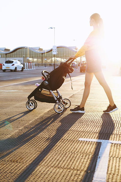 photo-of-woman-pushing-a-stroller-164711
