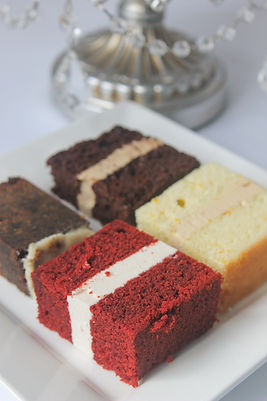 Samples of chocolate, red velvet, orange and fruit cakes