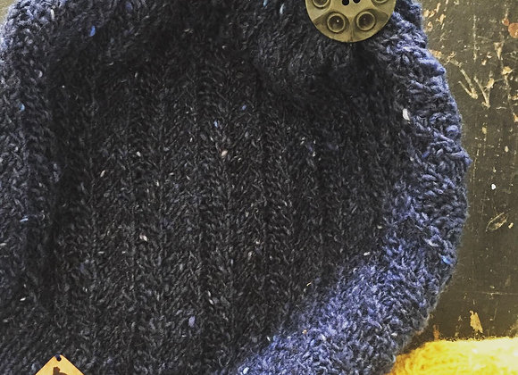 Hand-knit wool beanie with a vintage button