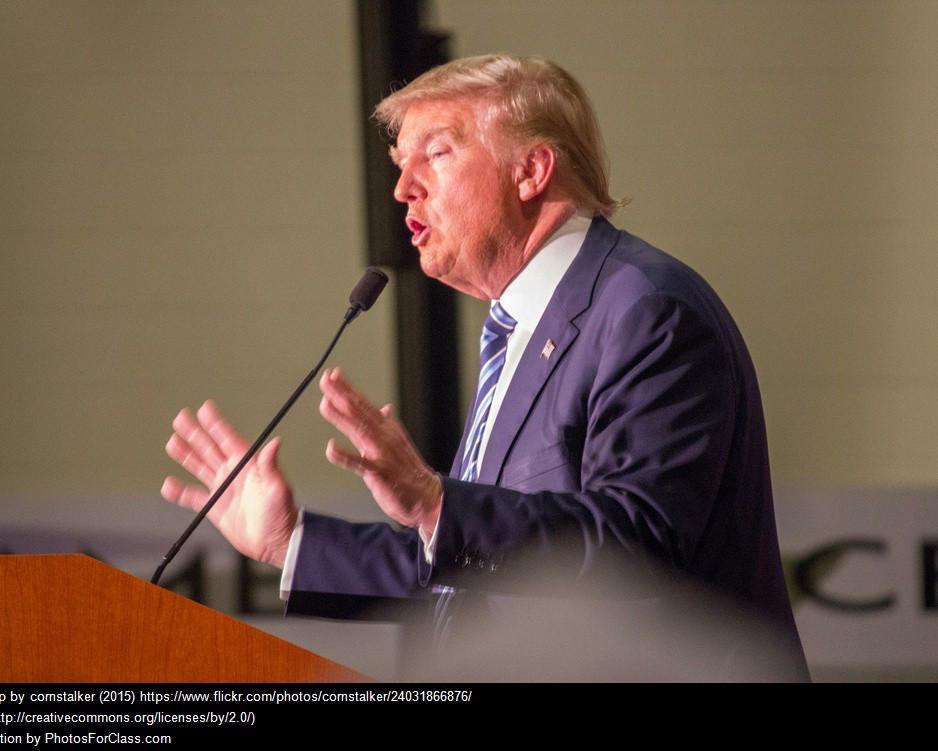 President Trump speaking at a podium