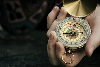 Close up of hand holding compass .jpg