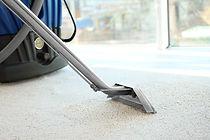 Steam vapor cleaner removing dirt from carpet in flat.jpg
